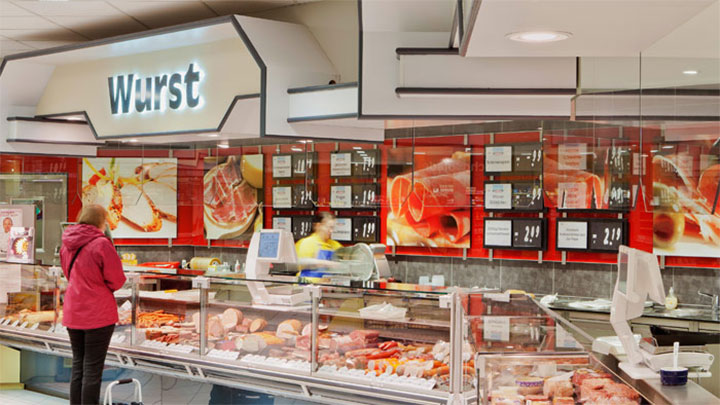 The meat section at Edeka Glückstadt illuminated by enhanced Philips Lighting solutions to improve freshness and appeal of meat