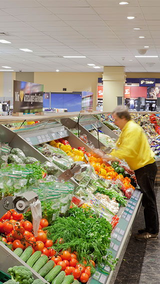 The vegetables section at Edeka Glückstadt lit by Philips Lighting's fresh food solutions