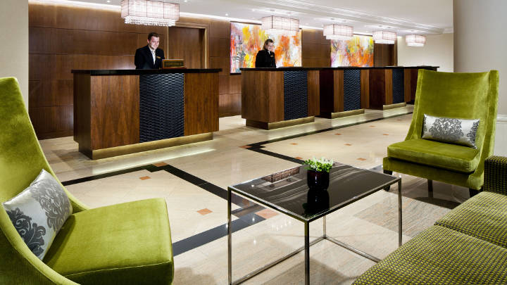 The reception of Marriott Hotel Prague illuminated by Philips lighting