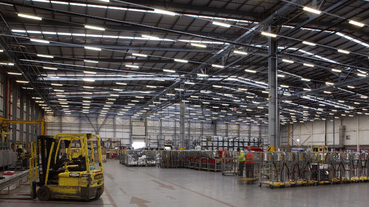 Royal Mail NDC warehouse lit by high-bay lighting of Philips Lighting