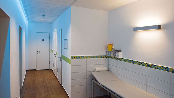 A hallway at Greifswald Radiology lit with Philips energy-efficient lighting