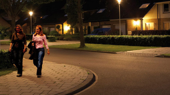 Women are walking in a street effectively illuminated by Philips