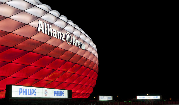 Allianz Arena red lights at night